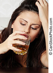 Alcohol addicted - Yound beautiful woman in depression,...