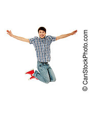 Young happy caucasian man jumping in the air , isolated on...