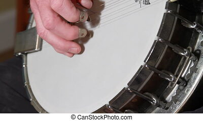 Old Hand Playing Banjo Two