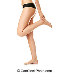 Ankle Injury. - Woman holding sore ankle, on white...