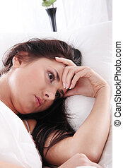 Insomnia - Young caucasian female on bed. Insomnia or...