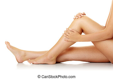 Knee Injury Woman holding on sore knee