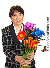 Mature woman offering flowers bouquet