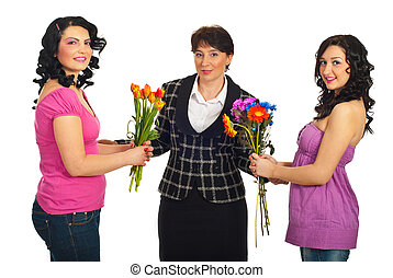 Daughters offering flowers to mother