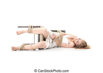 Kidnapping concept - The beautiful blond girl tied with rope...