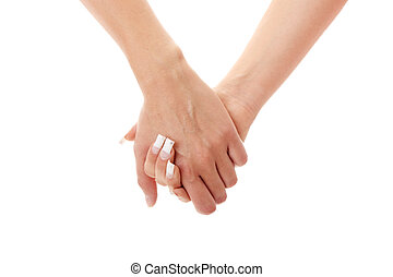 Two woman holding hands - Two woman holding their hands...
