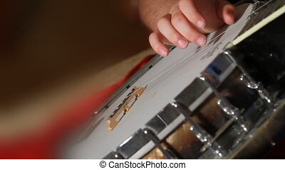 Small Child Hand Learning To play Banjo