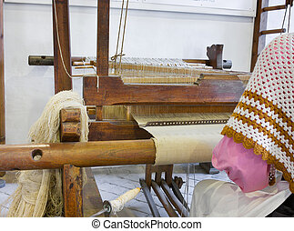 old loom, weaving home made fabric, textile work, woven...