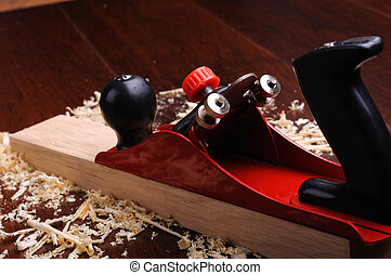 Shavings of wood, brick and red plane