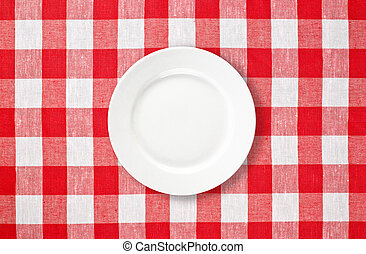 orange plate on red checked tablecloth - white plate on red...