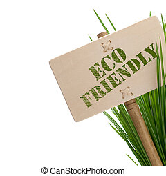green eco friendly message on a wooden panel and green plant...