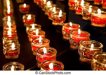 Votive Candles in a Church in a row