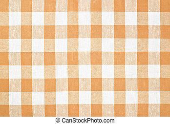 Brown or yellow checked tablecloth