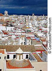 City scape of Cadiz with a dark blue sky