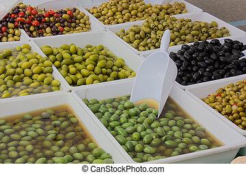 olives in pickle - olives salted preserved in brine or...