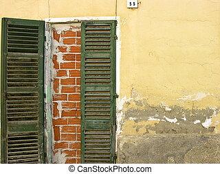 Bulwark door - Closed bulwark door on a ruined house in...