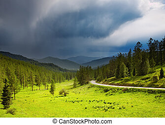 Mountain landscape with storm clouds