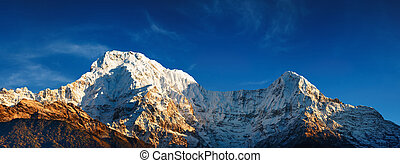 Annapurna South at sunrise - Mount Annapurna South at...