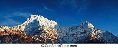 Annapurna South at sunrise - Mount Annapurna South at...