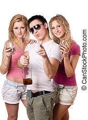 Joyful young people with a bottle of whiskey. Isolated