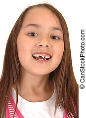 Girl loosing her teeth. - A young pretty girl six years old...