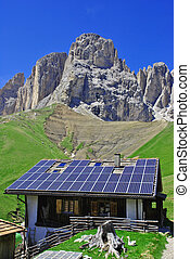 solar panels - house roof with solar panels background of...