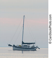 Classic traditional cutter rigged sailboat with bowsprit and...