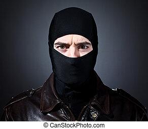 thief portrait - closeup portrait of caucasian criminal with...