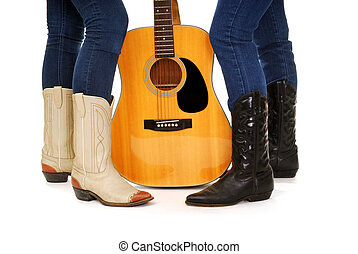 Guitar Cowgirls - Ladies legs in Cowboy Boots and an...