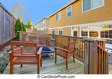 Back yard with porch and outdoor furniture. - Back yard of...