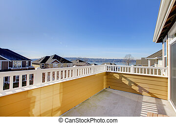 Balcony of the yellow house with water view