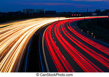 Light line of Highway - Cars at night on a highway. Rope...