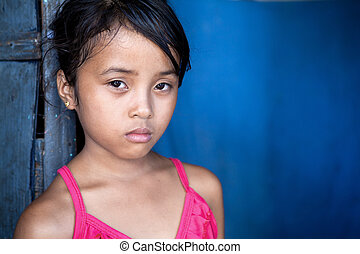 Young Asian girl over blue - Young Filipina girl 8 years old...
