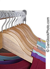 t shirts on cloth hangers - close up of t shirts on cloth...