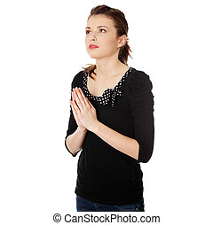 Closeup portrait of a young caucasian woman praying isolated...