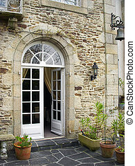 Old Rock Wall with French Doors - An open french door set in...