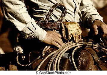 Working Cowboy Close-up - Close up of the hands and torso of...