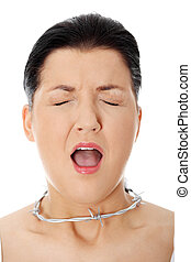 Young woman with barbed wire around her throat. - Throat...