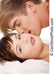 Beautiful young couple - Beautiful young couple lying in bed...