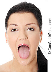 Tongue - Portrait of beautiful woman who puts tongue out