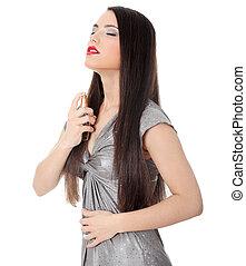 Beautiful woman applying perfume