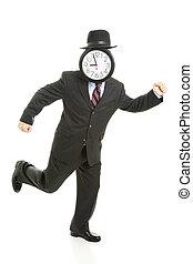 Running Late - Faceless businessman running late for work....