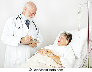 Doctor Reviews Medical History - Doctor reviews his hospital...