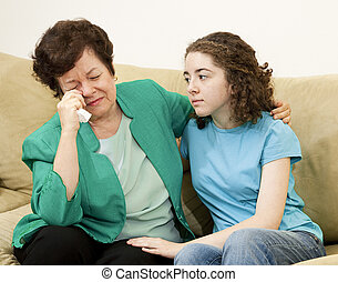 Teen Comforts Mother - Teenage girl tries to comfort her...