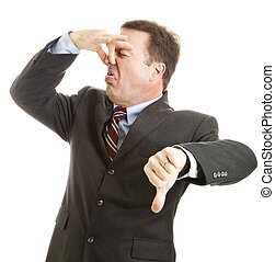 Businessman - It Stinks - Mature businessman holds his nose...