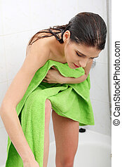 After bath - Beautiful woman wipes her wet body with a towel...