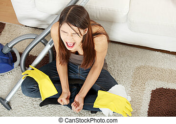 Frustration - Young woman hates cleaning home