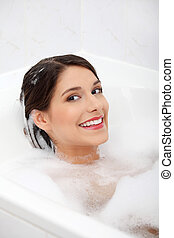Young woman taking bath - Young pretty woman taking bath