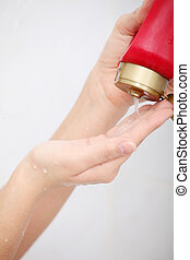 Liquid Gel Soap Pouring from Bottle into a Womans Hand