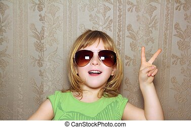 hand victory gesture little girl funny sunglasses retro...